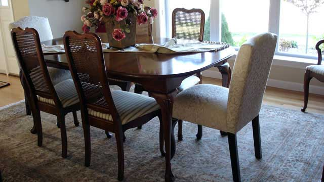 antique oriental rug beautifully tied into this client's dining room