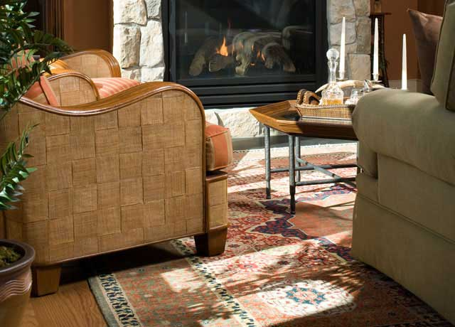 boyer interiors adding an octagon shaped table to enhance the antique tribal rug under it